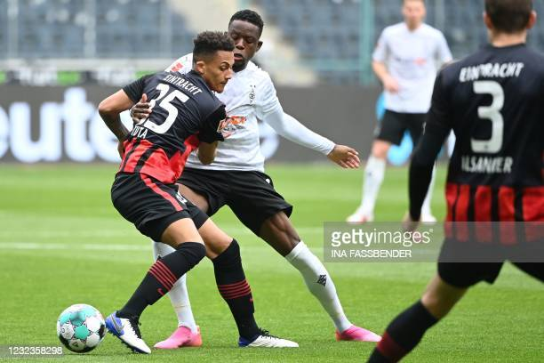 Frankfurt's Brazilian defender Lucas Silva Melo and Moenchengladbach's French forward Marcus Thuram vie for the ball during the German first division...