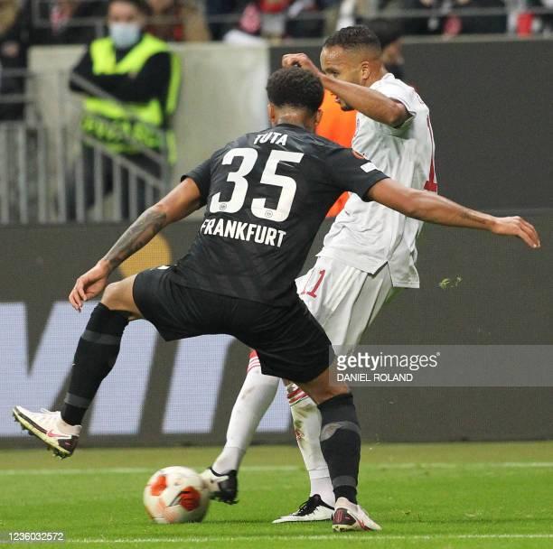 Frankfurt's Brazilian defender Lucas Silva Melo and Olympiakos' Moroccan forward Youssef El-Arabi vie for the ball during the UEFA Europa League...