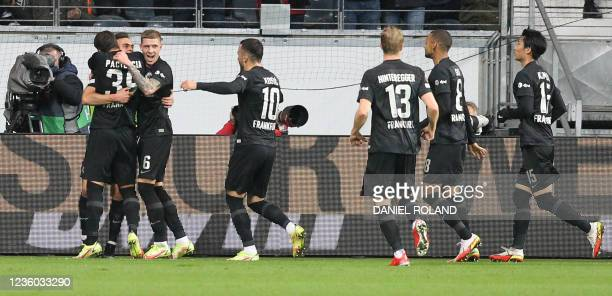 Frankfurt's Colombian forward Rafael Borre celebrates scoring the opening goal from the penalty spot with his teammates during the UEFA Europa League...