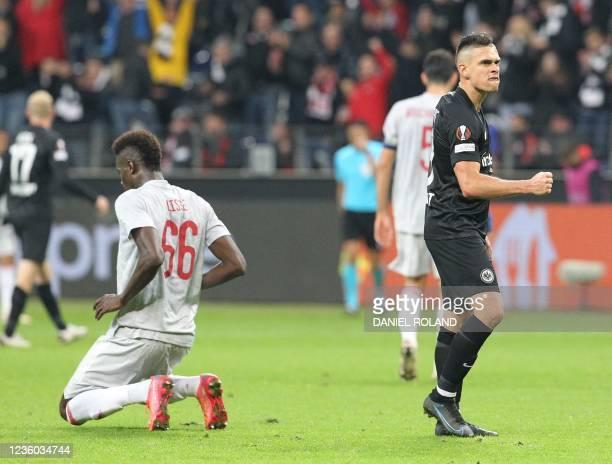 Frankfurt's Colombian forward Rafael Borre reacts at the final whistle next to Olympiakos' Senegalese defender Cisse Abdou the UEFA Europa League...