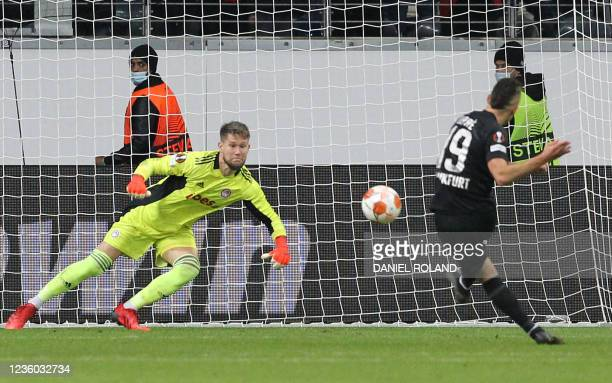 Frankfurt's Colombian forward Rafael Borre scores the opening goal from the penalty spot past Olympiakos' Czech goalkeeper Tomas Vaclik during the...