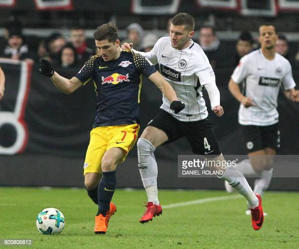 Frankfurt's Croatian forward Ante Rebic and Leipzig's Austrian midfielder Marcel Sabitzer vie for the ball during the German First division...