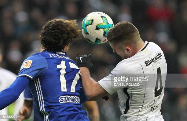 Frankfurt's Croatian forward Ante Rebic and Schalke's French midfielder Benjamin Stambouli vie for the ball during the German first division...
