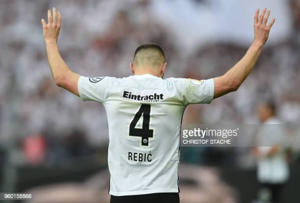 Frankfurt's Croatian forward Ante Rebic celebrates scoring the opening goal during the German Cup DFB Pokal final football match FC Bayern Munich vs...