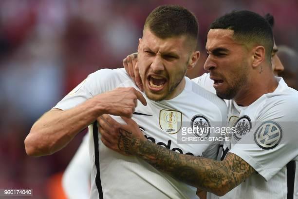 Frankfurt's Croatian forward Ante Rebic celebrates scoring the opening goal with his teammate Frankfurt's Spanish midfielder Omar Mascarell during...