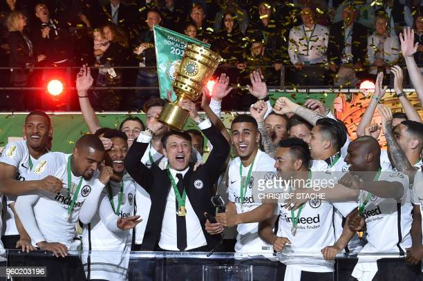 Frankfurt's Croatian head coach Niko Kovac and his players celebrate with the trophy after the German Cup DFB Pokal final football match FC Bayern...