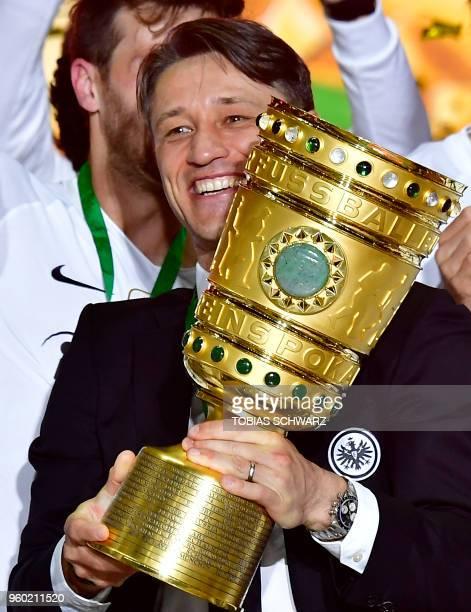 Frankfurt's Croatian head coach Niko Kovac celebrates with the trophy after the German Cup DFB Pokal final football match FC Bayern Munich vs...