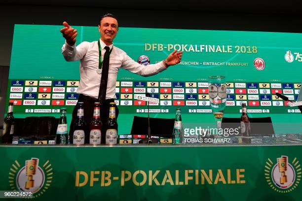 Frankfurt's Croatian head coach Niko Kovac reacts after his players soaked him in beer at the press conference after the German Cup DFB Pokal final...