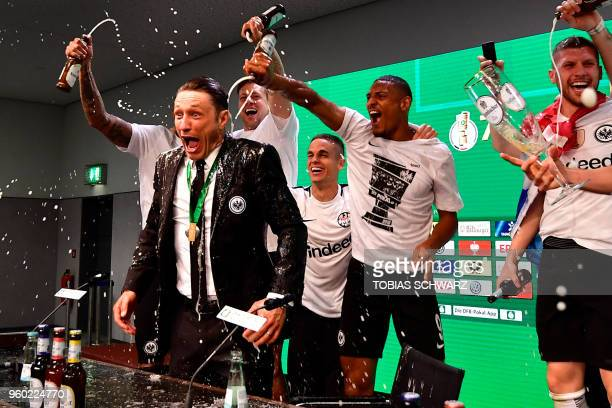 TOPSHOT Frankfurt's Croatian head coach Niko Kovac reacts after his players soak him in beer at the press conference after the German Cup DFB Pokal...