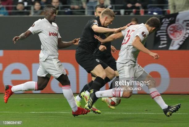 Frankfurt's Croatian midfielder Kristijan Jakic and Olympiakos' Greek defender Sokratis Papastathopoulos vie for the ball during the UEFA Europa...