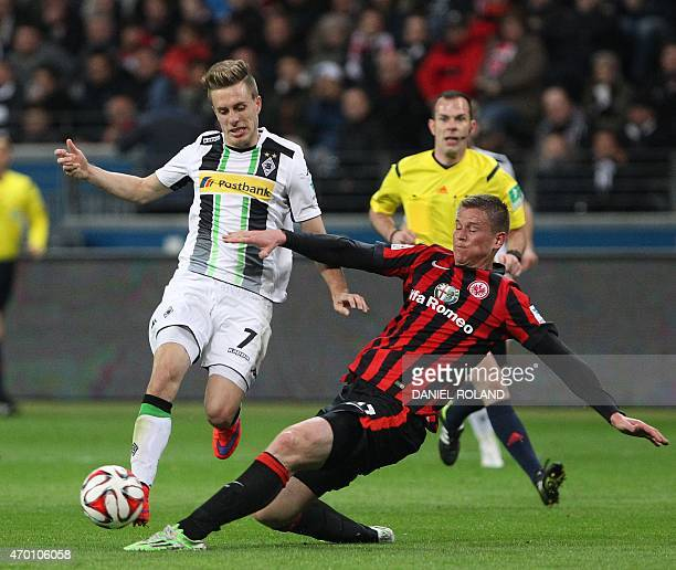 Frankfurt's defender Alexander Madlung and Moenchengladbach's midfielder Patrick Herrmann vie for the ball during the German first division...
