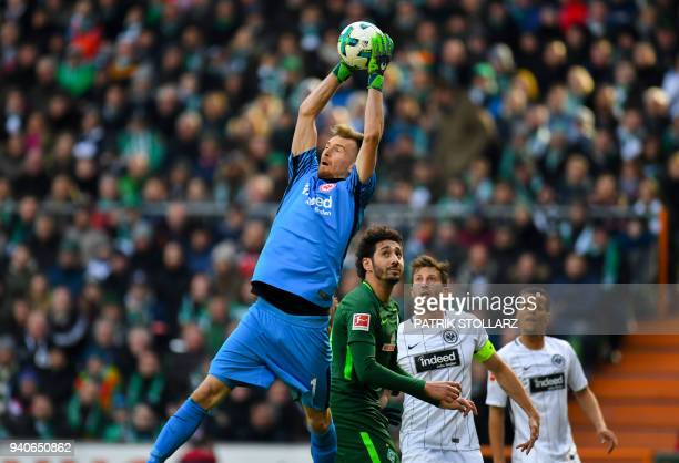 Frankfurt's Finnish goalkeeper Lukas Hradecky and Bremen's Algerian forward Ishak Belfodil vie for the ball during the German first division...