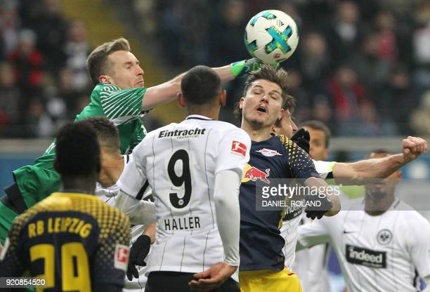 Frankfurt's Finnish goalkeeper Lukas Hradecky and Leipzig's Austrian midfielder Marcel Sabitzer vie for the ball during the German First division...