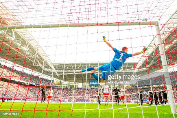 Frankfurt´s Finnish goalkeeper Lukas Hradecky saves a ball during the German dirst division Bundesliga football match between RB Leipzig and...
