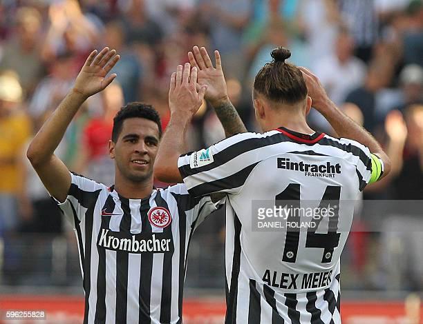 Frankfurt's forward Alexander Meier celebrates and Frankfurt's Spanish midfielder Gonzales Omar Mascarell the 10 victory after the German first...