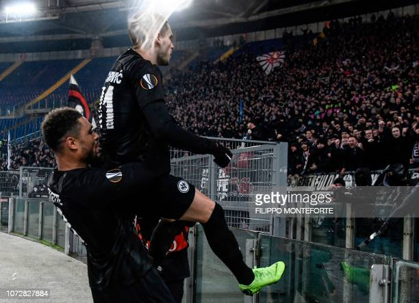 Frankfurt's French defender Simon Falette carries Frankfurt's Serbian midfielder Mijat Gacinovic towards the fans as he celebrates after scoring an...