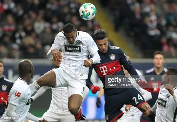 Frankfurt's French forward Sebastien Haller and Bayern Munich's French midfielder Corentin Tolisso vie for the ball during the German first division...