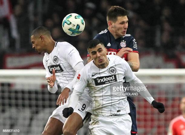 Frankfurt's French forward Sebastien Haller and Frankfurt's German midfielder Aymen Barkok and Bayern Munich's German defender Niklas Suele vie for...