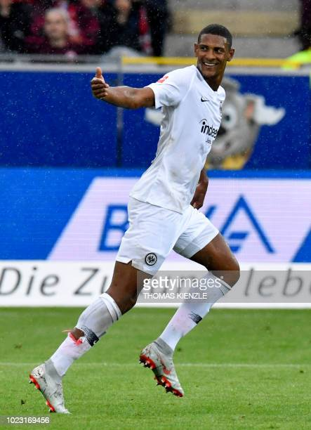 Frankfurt's French forward Sebastien Haller celebrates scoring during the German first division Bundesliga football match SC Freiburg v Eintracht...