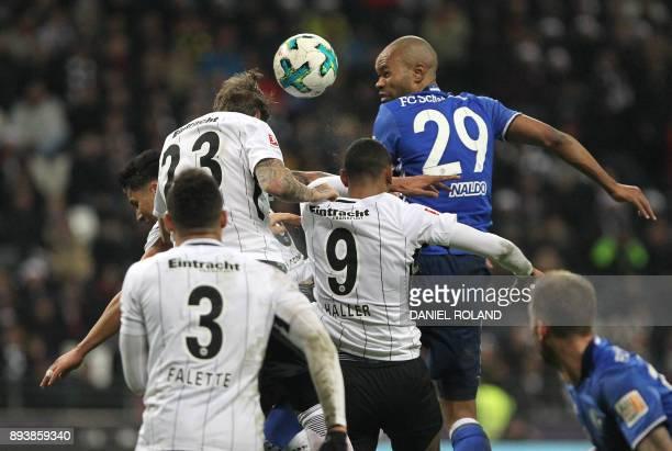 Frankfurt's French forward Simon Falette Frankfurt's German defender Marco Russ and Frankfurt's French forward Sebastien Haller vie with Schalke's...
