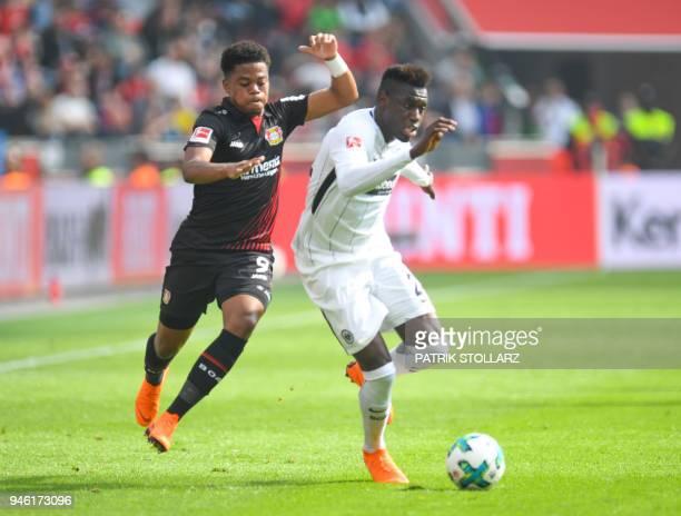 Frankfurt's German defender Danny da Costa and Leverkusen's Jamaican midfielder Leon Bailey vie for the ball during the German first division...