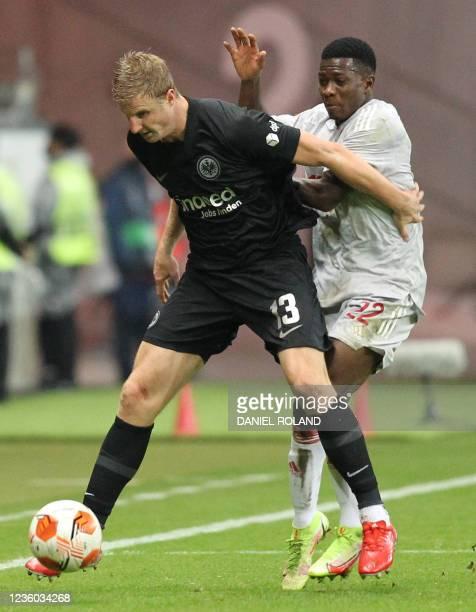 Frankfurt's German defender Martin Hinteregger and Olympiakos' Guinean midfielder Aguibou Camara vie for the ball during the UEFA Europa League group...