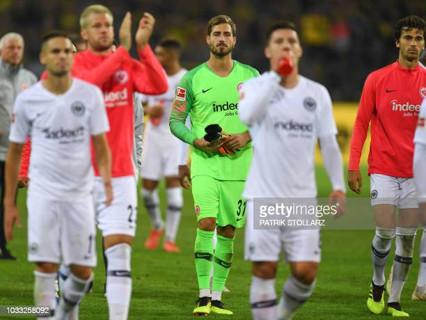 Frankfurt's German goalkeeper Kevin Trapp and his teammates react after the German first division Bundesliga football match Borussia Dortmund v...