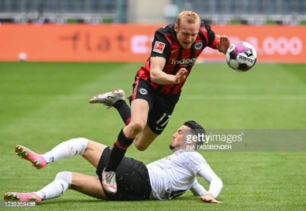 Frankfurt's German midfielder Sebastian Rode and Moenchengladbach's Algerian defender Ramy Bensebaini vie for the ball during the German first...
