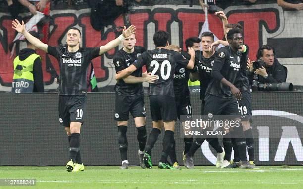 Frankfurt's German midfielder Sebastian Rode celebrates scoring the 20 goal with his teammates during the UEFA Europa League quarterfinal second leg...