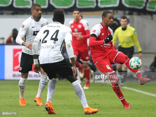 Frankfurt's Ghanaian midfielder KevinPrince Boateng and Frankfurt's German defender Danny da Costa and Mainz' French defender Abdou Diallo vie for...