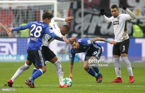 Frankfurt's Ghanaian midfielder KevinPrince Boateng and Schalke's Austrian midfielder Alessandro Schoepf and Austrian forward Guido Burgstaller vie...