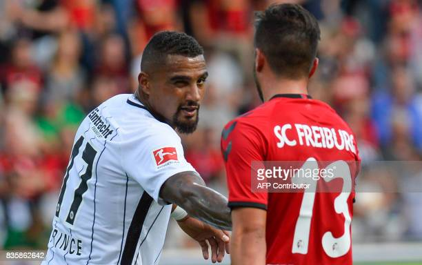 Frankfurt's Ghanaian midfielder KevinPrince Boateng shakes hand with Freiburg's midfielder Marco Terrazzino after the German first division...