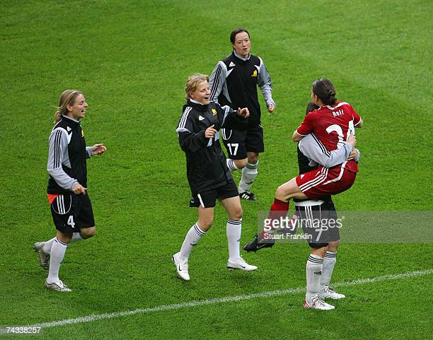 Frankfurt's goalkeeper Ursula Holl celebrates with teammate Pia Wunderlich during the Women's DFB German Cup final between FFC Frankfurt and FCR...