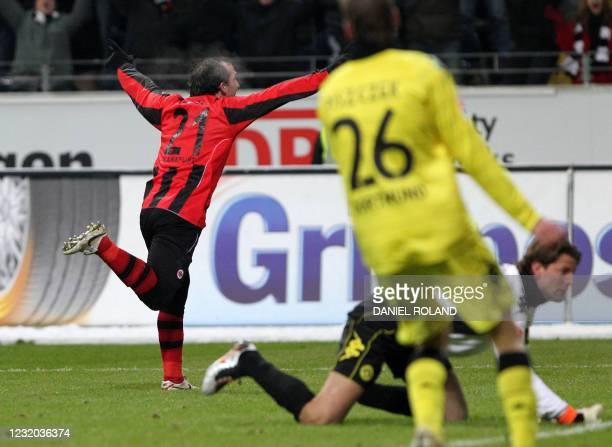 Frankfurt's Greek striker Theofanis Gekas celebrates scoring the opening goal during the German first division Bundesliga football match Eintracht...