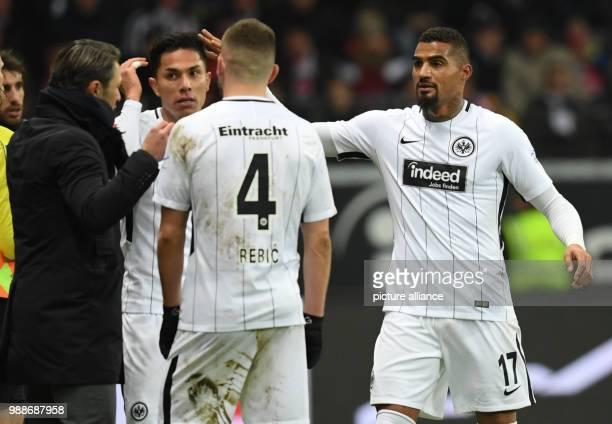 Frankfurt's head coach Niko Kovac speaks to his players Carlos Salcedo Ante Rebic and KevinPrince Boateng during the German Bundesliga match between...