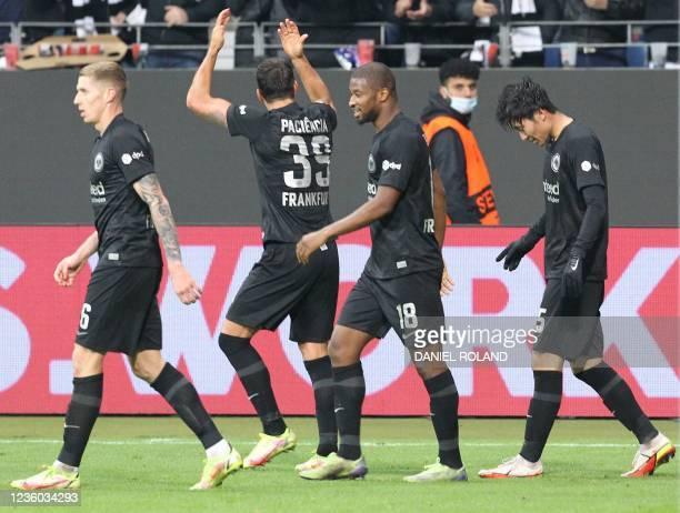 Frankfurt's Japanese midfielder Daichi Kamada celebrates scoring the 3-1 goal with his teammates during the UEFA Europa League group D football match...