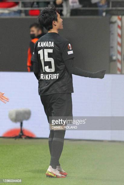 Frankfurt's Japanese midfielder Daichi Kamada celebrates scoring the 3-1 goal during the UEFA Europa League group D football match between Eintracht...