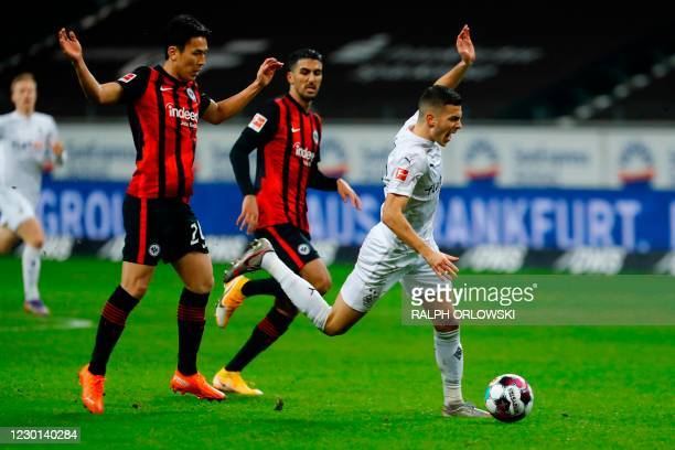 Frankfurt's Japanese midfielder Makoto Hasebe and Moenchengladbach's Slovakian midfielder Laszlo Benes vie for the ball during the German first...