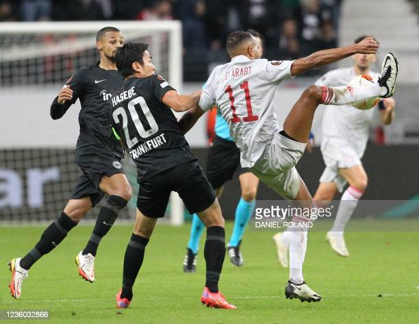 Frankfurt's Japanese midfielder Makoto Hasebe and Olympiakos' Moroccan forward Youssef El-Arabi vie for the ball during the UEFA Europa League group...
