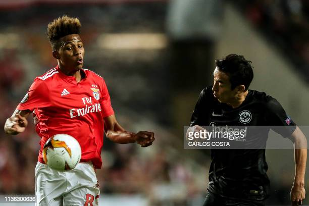 Frankfurt's Japanese midfielder Makoto Hasebe vies with Benfica's Portuguese midfielder Gedson Fernandes during the UEFA Europa league quarter final...