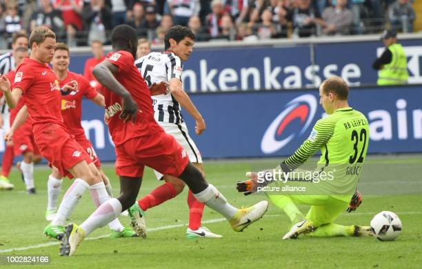 Frankfurt's Jesus Vallejo scores the 12 goal past Leipzig's goalkeeper Peter Gulacsi as well as Leipzig's Benno Schmitz Dominik Kaiser and Dayot...