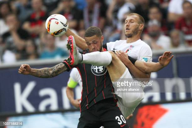 Frankfurt's Luc Castaignos and Augsburg's Ragnar Klavan battle for the ball during the game between Eintracht Frankfurt and FC Augsburg in the...