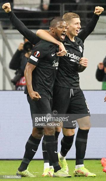 Frankfurt's Malian defender Almamy Toure celebrates scoring the 2-1 goal with his teammates during the UEFA Europa League group D football match...