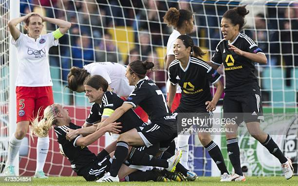 Frankfurt's Mandy Islacker celebrates with teammates after scoring the winning goal during the UEFA Champions League women football match final Paris...