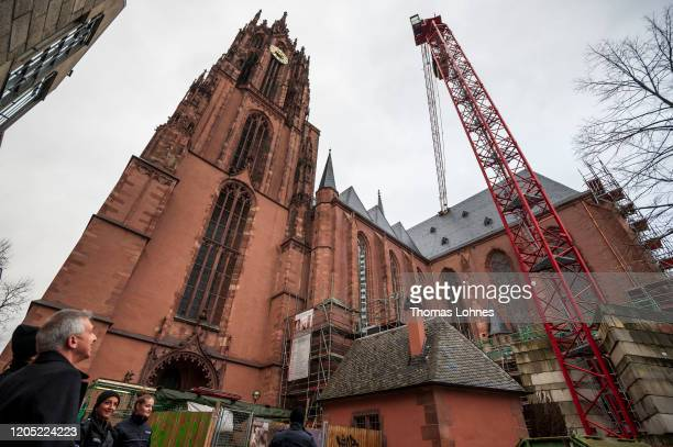 Frankfurts Mayor Peter Feldmann looks to a crane that had damaged the roof of the Frankfurter Dom cathedral following high winds from storm Sabine on...