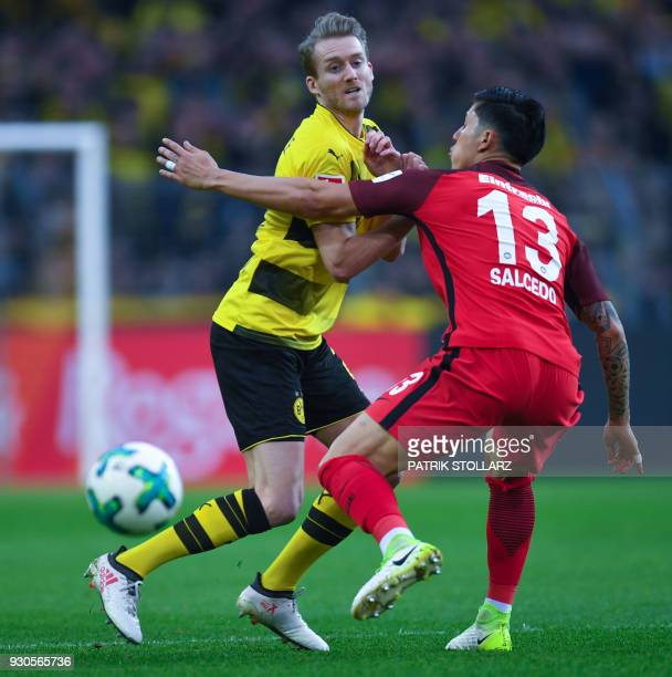 Frankfurt's Mexican defender Carlos Salcedo and Dortmund's German midfielder Andre Schuerrle vie for the ball during the German first division...
