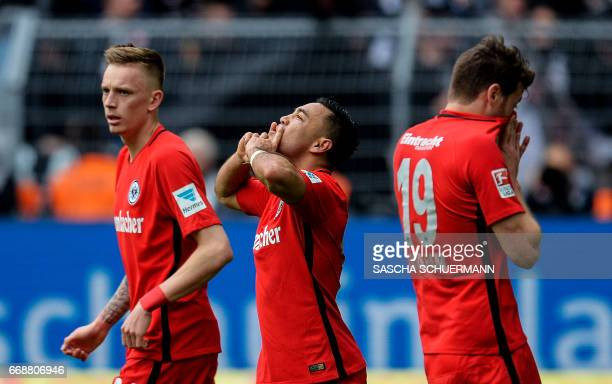 Frankfurt's Mexican midfielder Marco Fabian celebrates scoring the 11 with his teammates during the German First division Bundesliga football match...