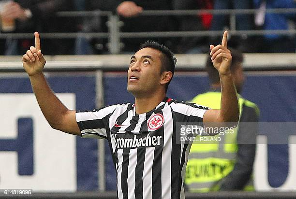 Frankfurt's Mexican midfielder Marco Fabian celebrates scoring the 22 during the German first division Bundesliga football match between Eintracht...