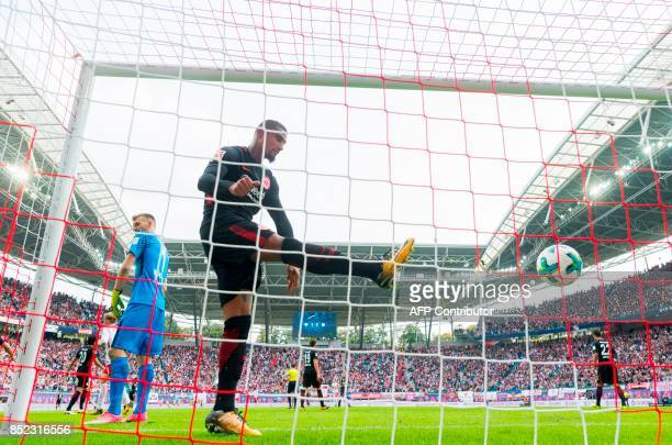 Frankfurt´s midfielder KevinPrince Boateng kicks the ball off the net after Leipzig´s forward Timo Werner scored the second goal during the German...