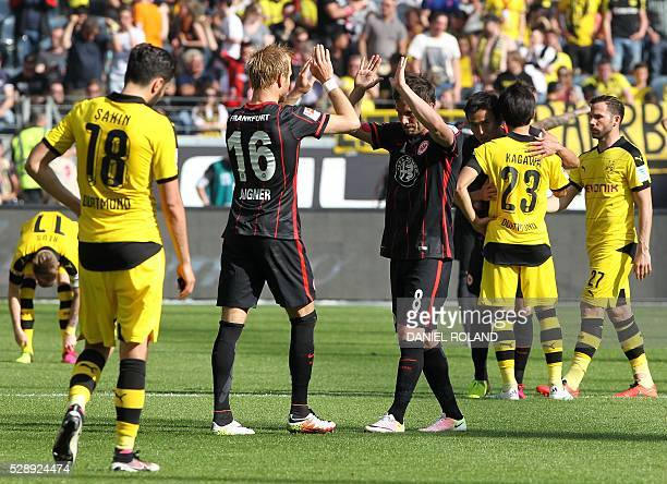 Frankfurt's players celebrate the 10 victory after the German first division Bundesliga football match between Eintracht Frankfurt and Borussia...
